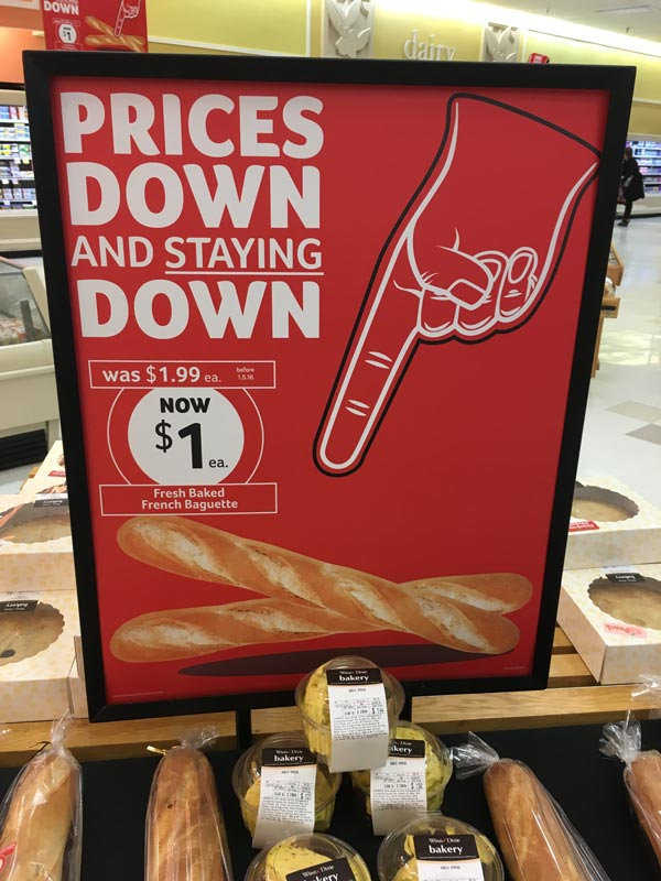 Product signage using an image of a foam finger.